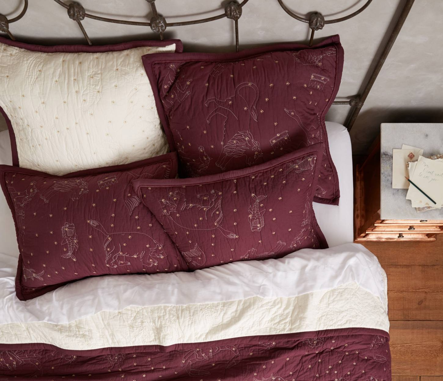 Anthropologie-Cosmos-Coverlet-in-Burgundy